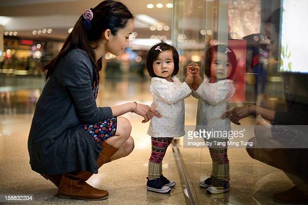 Pretty young mom shopping with baby in the mall