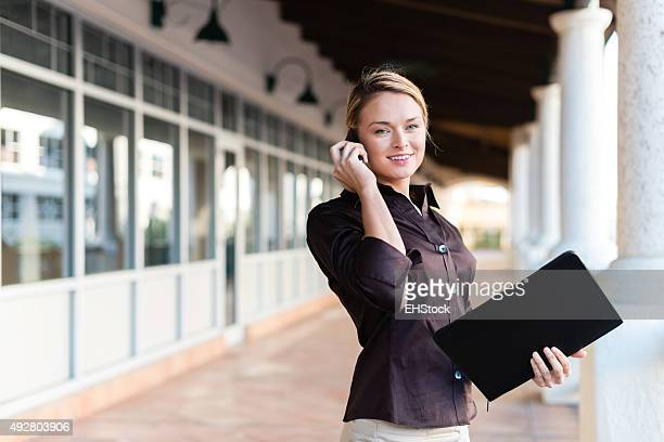 Pretty Young Office Worker on Phone