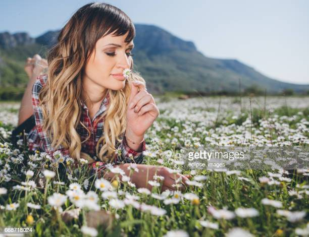 Pretty young teenage girl relaxing on a grass