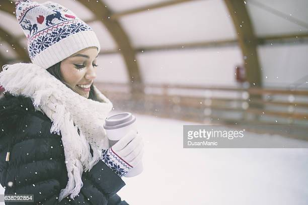 Pretty young woman at ice-skating rink