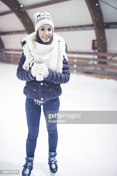 pretty young woman at ice-skating rink - hot body girls stock photos and pictures