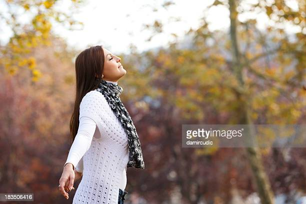 Pretty young woman enjoying the nature