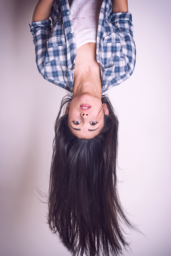 Pretty young woman hanging upside down - gettyimageskorea