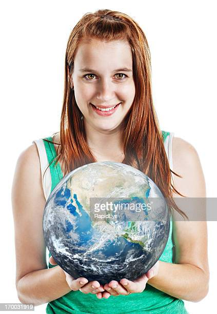 Pretty young woman holding up the world smiles