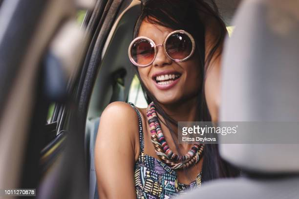 pretty young woman in a car - one young woman only stock pictures, royalty-free photos & images