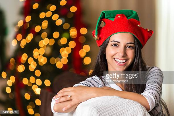 pretty young woman in elf hat - lebanese ethnicity stock photos and pictures