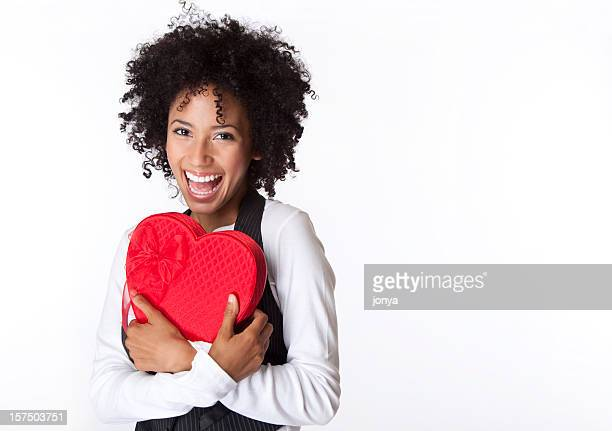 pretty young woman laughing with Valentine box in her arms