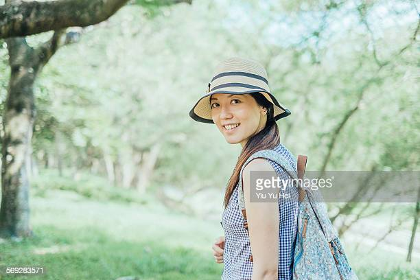 pretty young woman smiling among the green forest - yiu yu hoi stock pictures, royalty-free photos & images