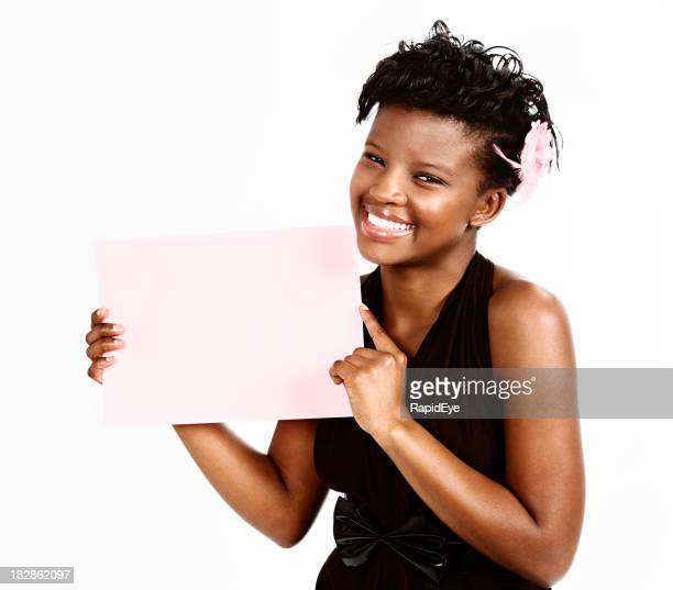 Pretty young woman smilingly displays blank sign