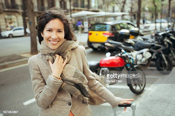 Pretty young woman standing in street