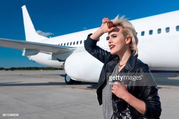 Pretty young woman standing outdoors at airport