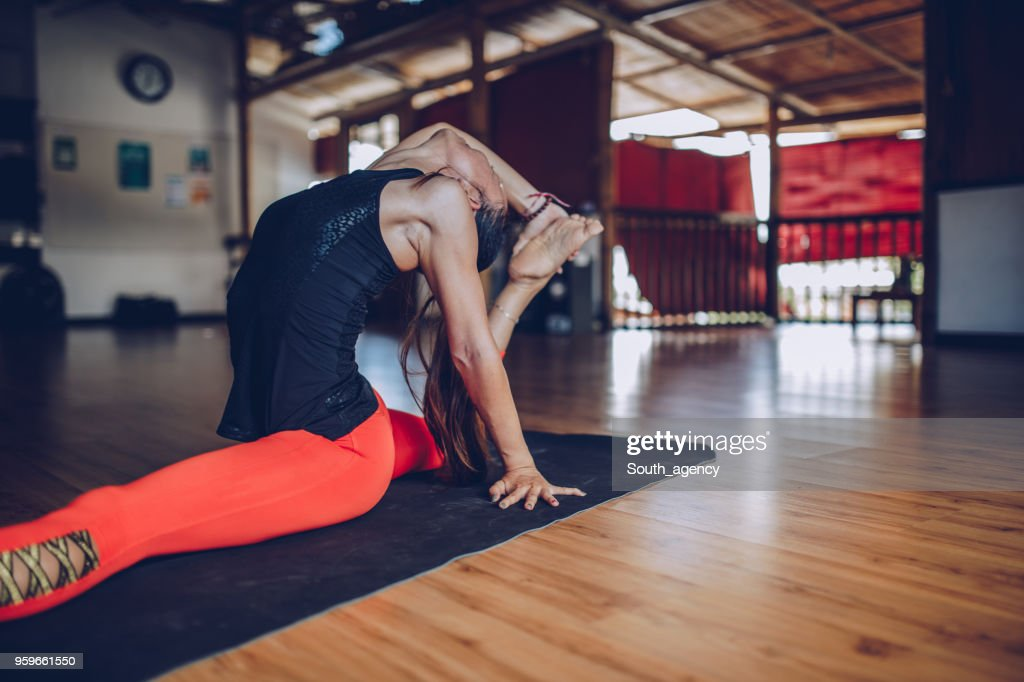 Pretty Young Woman Stretching : Stock Photo