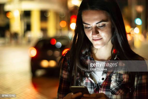 Pretty young woman using her phone