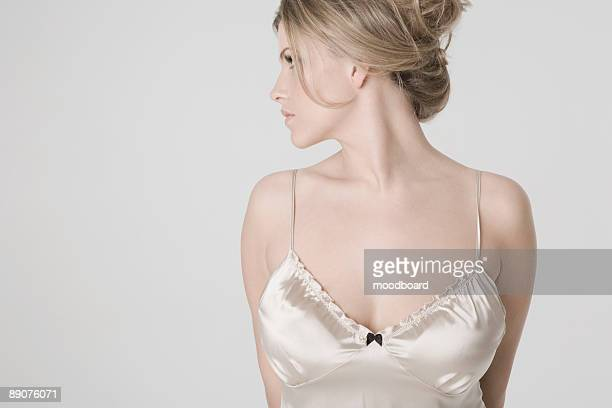 pretty young woman wearing sexy nightshirt, profile - camisole stock photos and pictures
