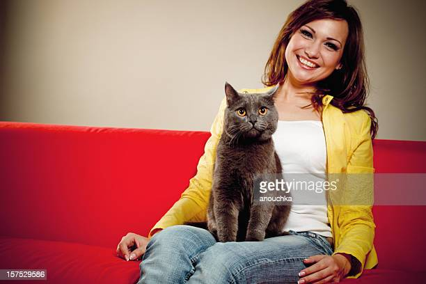 Pretty Young Woman  with her lovely british shorthair cat