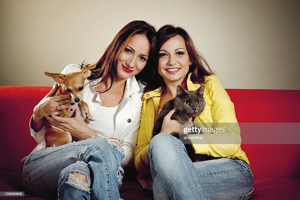 Pretty Young Woman  with thir lovely dog and cat : Stock Photo