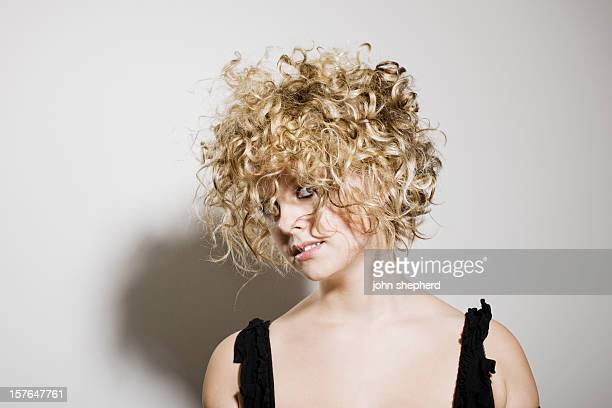 Pretty young woman with wild crazy blonde hair