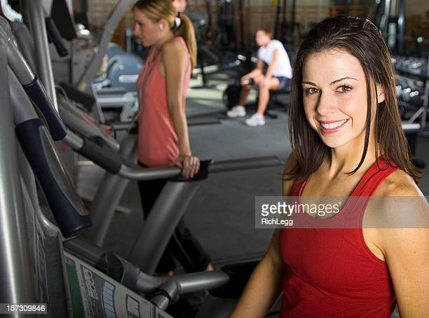 pretty young woman working out in a health club - rich_legg stock photos and pictures