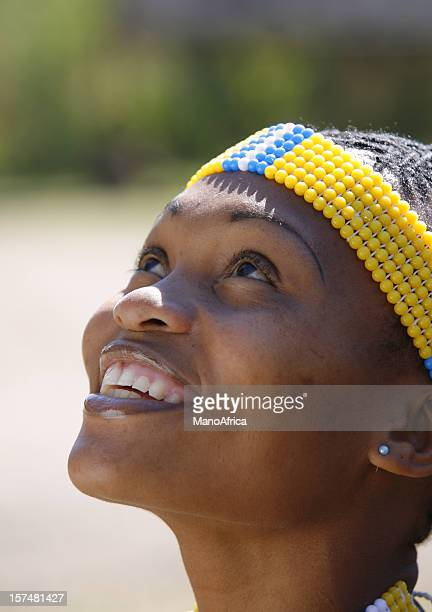 pretty zulu woman looking up - zulu women stock pictures, royalty-free photos & images