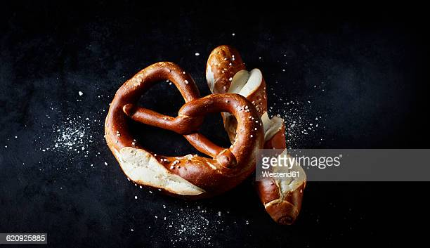 Pretzel and pretzel roll on dark ground