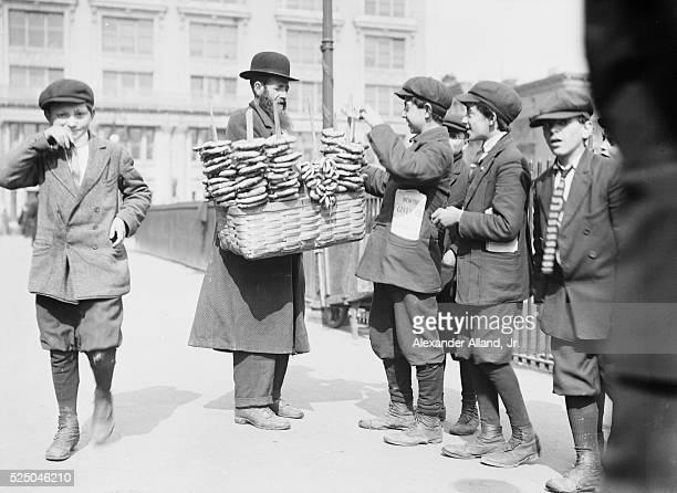 Pretzel vendor and boys. Lower East Side, New York City.