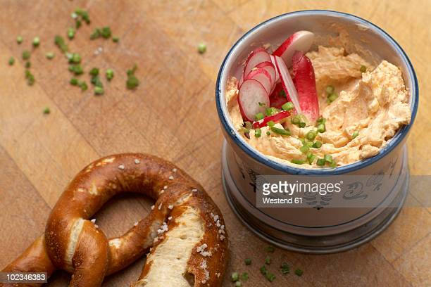 Pretzel with savoury cheese spread