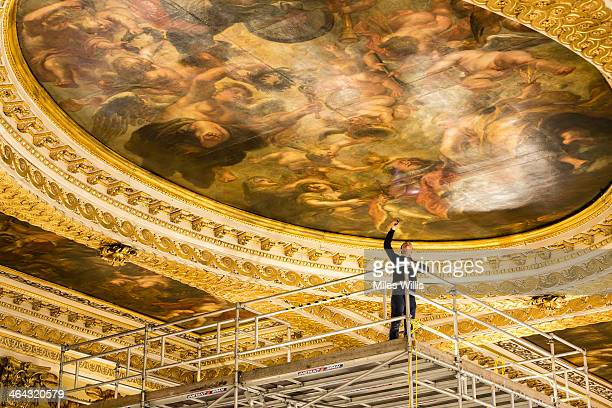 Preventive conservation co-ordinator at Historic Royal Palaces Jonathan Bridal inspects the Rubens ceiling paintings for damage during a conditioning...