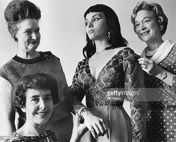 JUN 10 1963 JUN 12 1963 Preview of Cleopatra's Costumes Committee members of the sponsoring groups for twin premieres of Cleopatra inspect a purple...