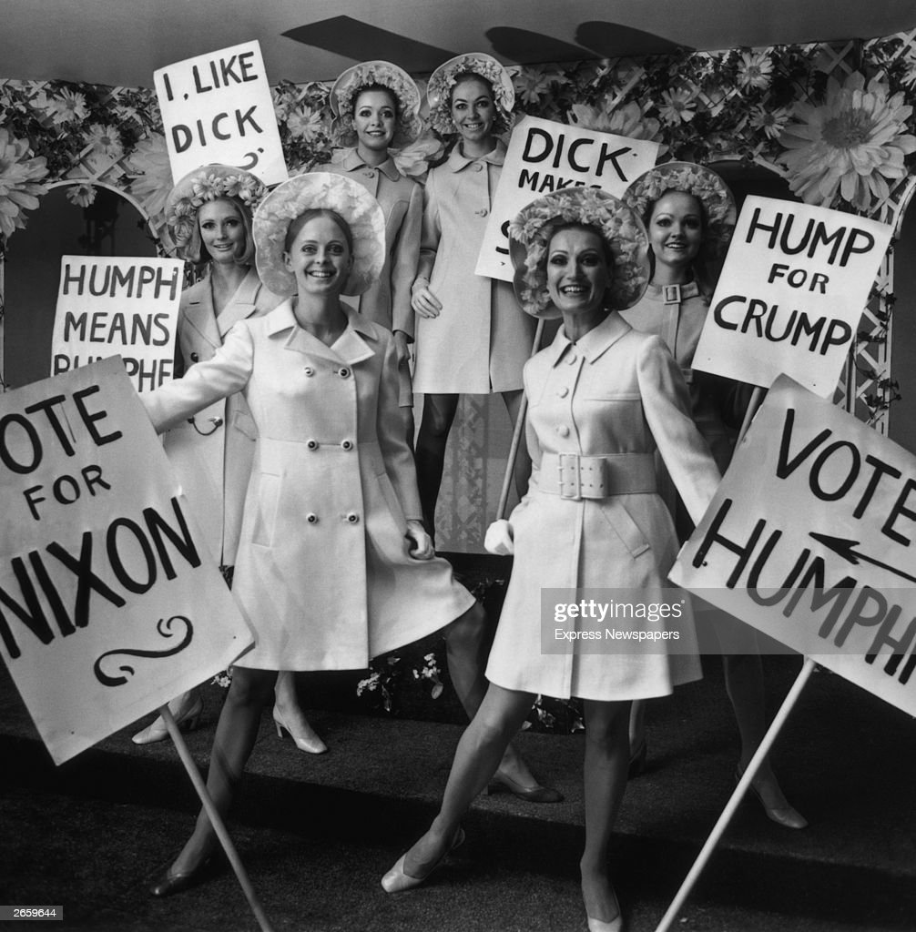 A preview of models for the clothing export council, holding placards supporting Nixon's bid for the presidency of America. Their placards read 'I Like Dick' and 'Hump For Crump'.