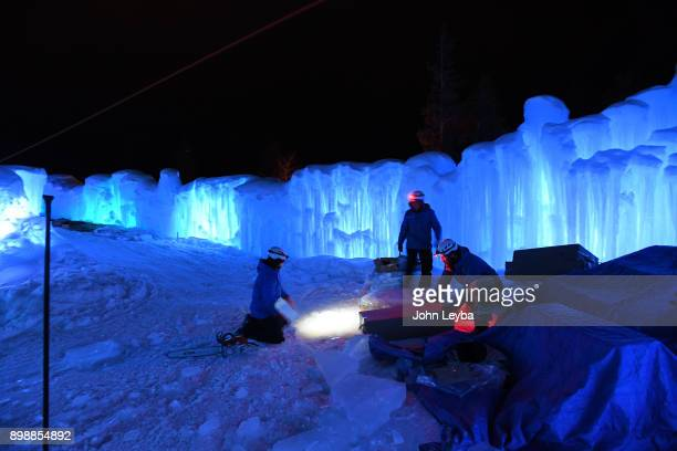 A preview of the Ice Castle at Dillon Town Park on December 26 2017 in Dillon Colorado Ice Crew works on the giant slide before its opening later in...