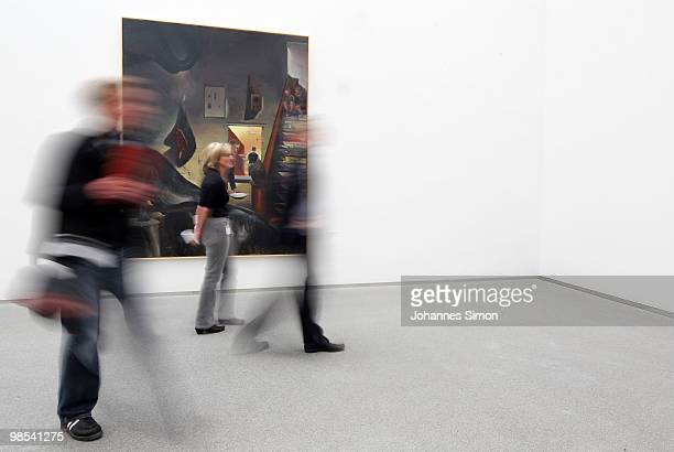 Preview visitors attend the Neo Rauch exhibition 'Begleiter' at Pinakothek der Moderne art museum on April 19 2010 in Munich Germany Due to his 50th...