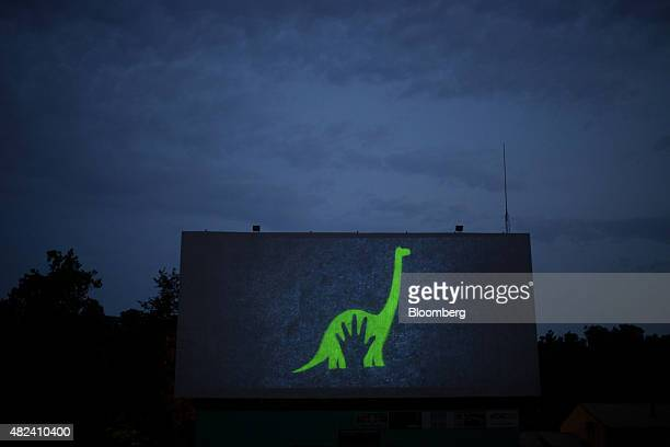 Previews play on a movie screen at the Georgetown DriveIn movie theater in Georgetown Indiana US on Friday July 17 2015 Consumer confidence fell last...
