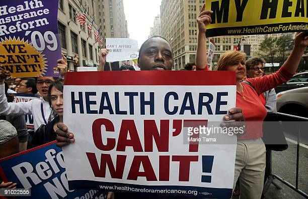 Previn Mosley stands with other health care reform supporters at a 'Big Insurance Sick of It' rally September 22 2009 in New York City The protest is...