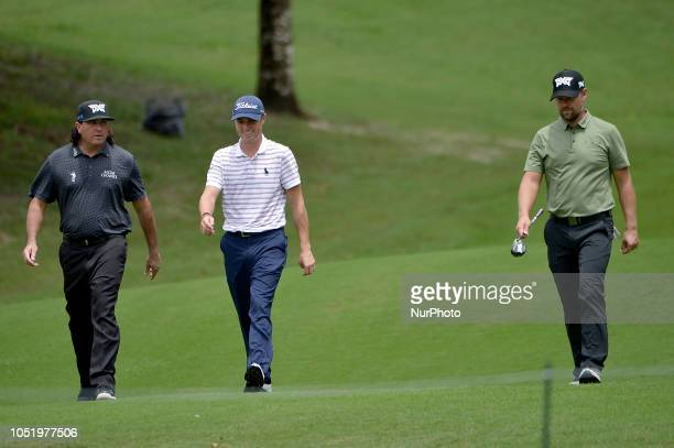 Previous champions Pat Perez , Justin Thomas and Ryan Moore of the USA walk on the fairway during the second round of 2018 CIMB Classic golf...