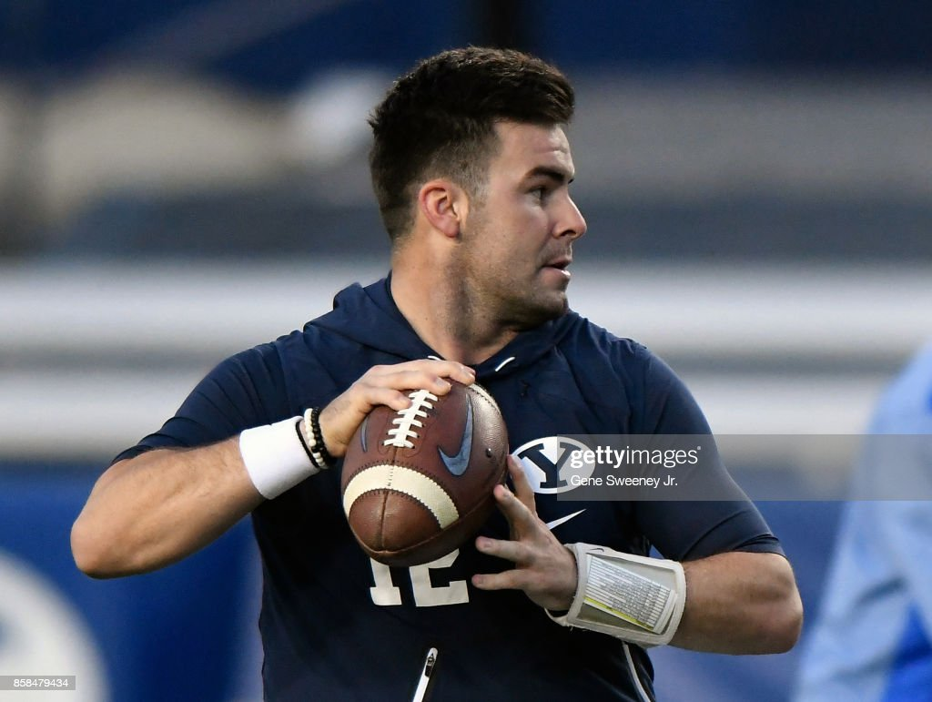 Previously hurt quarterback Tanner Mangum #12 of the Brigham Young Cougars looks to throw the ball before their game against the Boise State Broncos at LaVell Edwards Stadium on October 6, 2017 in Provo, Utah.