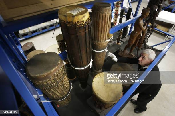 Previously unissued photo dated 18/12/12 of Glasgow Museum employee Joe O'Hara pictured with a collection of drums at the Glasgow Museum Resource...
