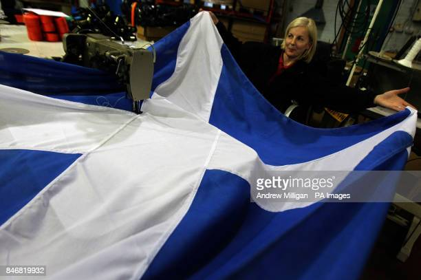 Previously unissued picture dated 18/01/12 of seamstress Tracey Watt from Flags and Banners in Baillieston near Glasgow putting the finishing touches...