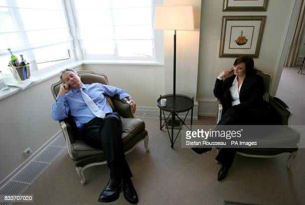 Previously unreleased image of Britain's Prime Minister Tony Blair speaking to his son Leo on the phone from his hotel room at the G8 Summit in...