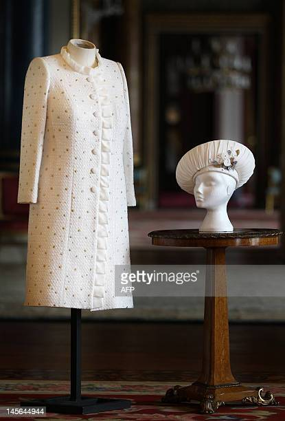 Previously unreleased photo and taken on May 31 2012 shows the ivory dress and coat in white Boucle fabric and threaded throughout with silk ribbon...