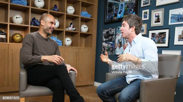 Previously unreleased photo dated 26/05/16 of Noel Gallagher interviewing new Manchester City Manager Pep Guardiola at the Manchester City Football...