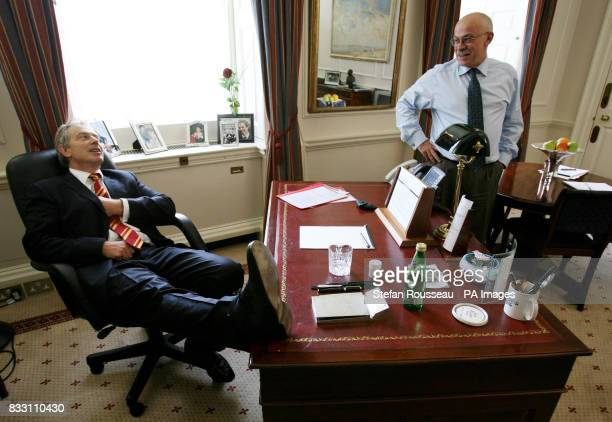 Previously unreleased photo of Prime Minister Tony Blair at his desk in his office known as his 'den' at 10 Downing Street with Director of...