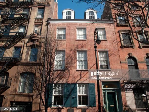 Pre-war red brick townhouse in the West Village, Manhattan, New York City