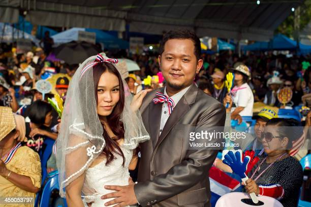 CONTENT] Prewedding photographs in front of the rally at Democracy Monument the center of the antigovernment rally site