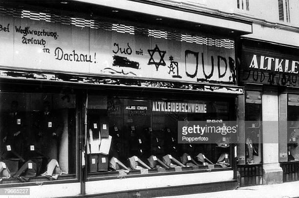PreWorld War II 15th September 1938 Vienna Austria Persecution of Jews AntiJewish slogans and signs on a Jewish Clothing Shop Dachau daubed on the...