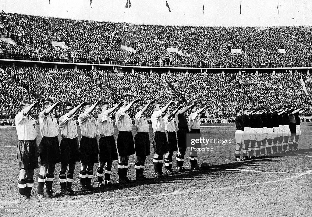Pre-World War II, Football, 15th May 1938, Prior to their International football match in Berlin+s Olympic stadium, the England team (left) gave the nazi salute as the German national anthem was played, The game ended in a 6-3 victory for England watched  : News Photo
