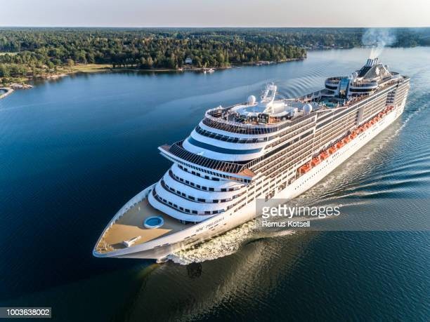 msc preziosa cruiser ship passing by in the stockholm swedish archipelago - cruise stock pictures, royalty-free photos & images