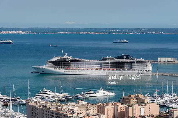 msc preziosa in the harbor of palma de mallorca - palma majorca stock photos and pictures