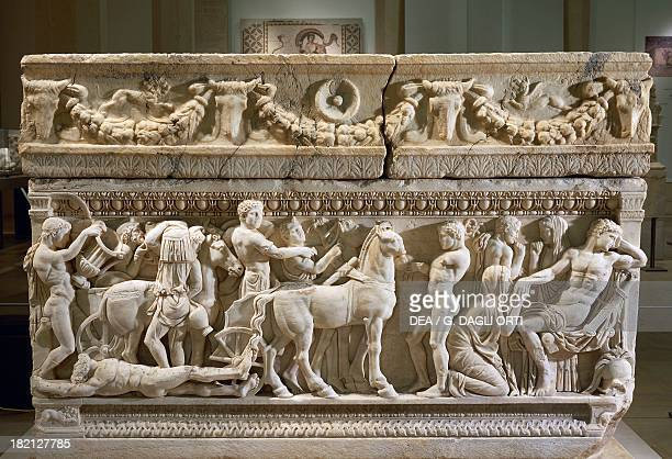 Priam on his knees before Achilles imploring the return of Hector's body tied to a war chariot detail of a marble sarcophagus with relief depicting...
