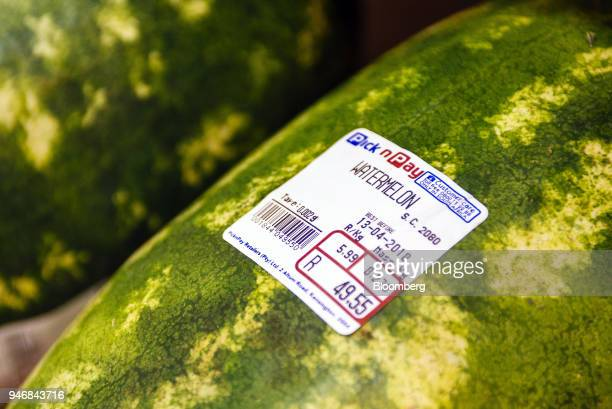 A price and weight information sticker is displayed on a watermelon inside a Pick n Pay Stores Ltd supermarket in Johannesburg South Africa on Monday...