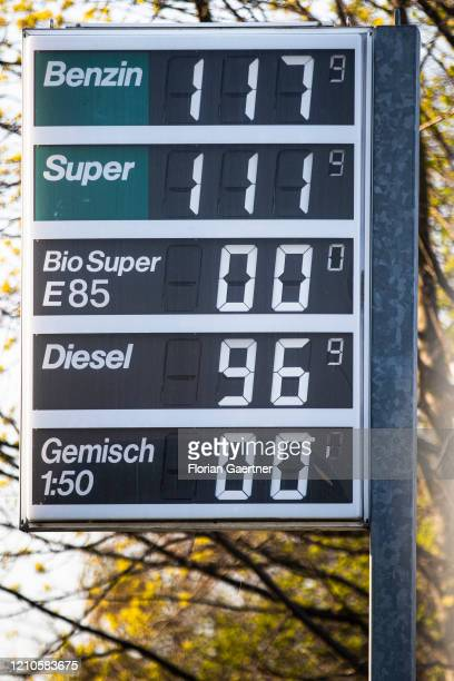 Price board in front of a petrol station with very low prices is pictured on April 21, 2020 in Jaenkendorf, Germany. Because of the decreasing demand...